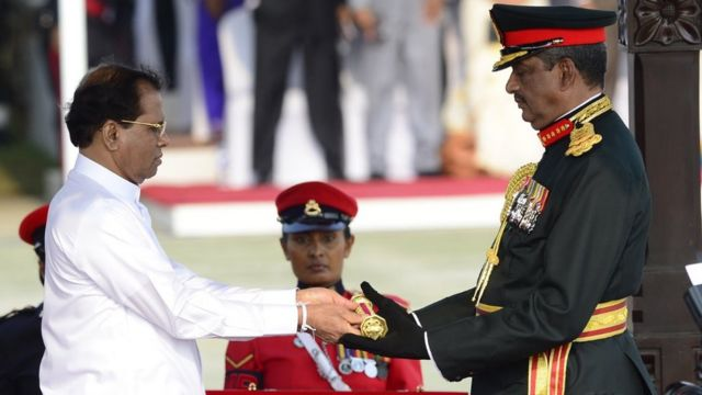Sri Lanka's President Maithripala Sirisena (L) confers the honorary military rank of field marshal on retired army general and defeated presidential candidate Sarath Fonseka (R) on March 22, 2015 at a ceremony in the capital Colombo. Sri Lanka's new government March 22 conferred the highest military rank of field marshal on retired army chief Sarath Fonseka, who had been jailed for alleged treason by the previous regime.