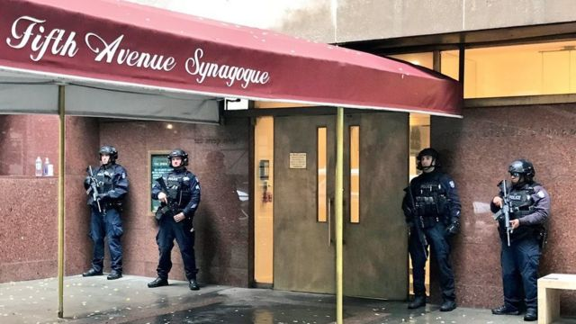 Armed police guard a synagogue in New York