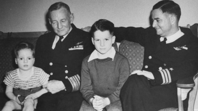John S. McCain III (C) as a young boy with his grandfather Vice Admiral John S. McCain Sr. ( (L) and father Commander (late admiral) John S. McCain Jr