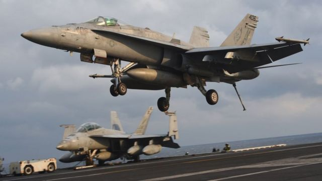 An F/A-18 fighter lands on the deck of the Nimitz-class aircraft carrier USS Carl Vinson during a South Korea-US joint military cxercise in seas east of the Korean Peninsula on 14 March 2017.