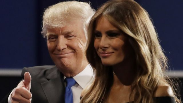 Republican presidential nominee Donald Trump walks off the stage with his wife Melania Trump