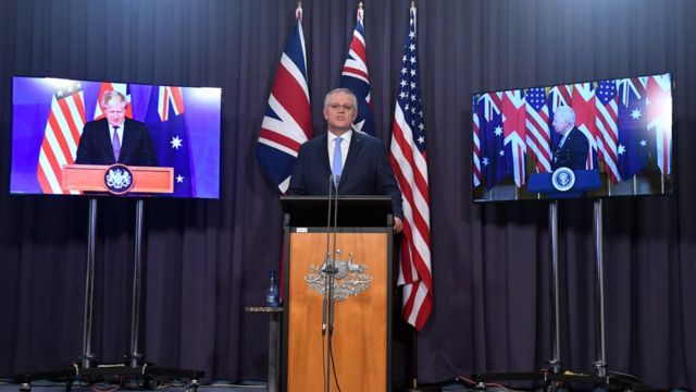 Scott Morrison (centre) speaks in a joint virtual press conference with his US and UK counterparts in announcing the Aukus security pact.