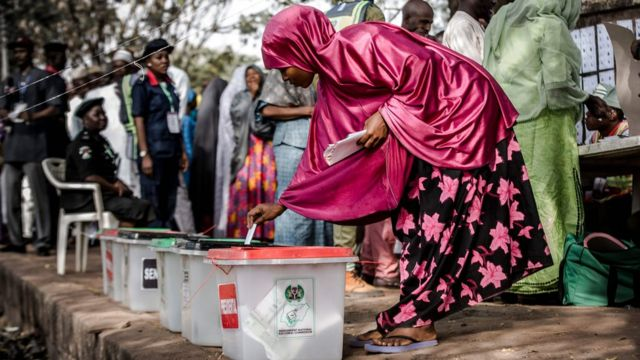 A Nigerian woman casts her vote for a candidate in the presidential election at Agiya