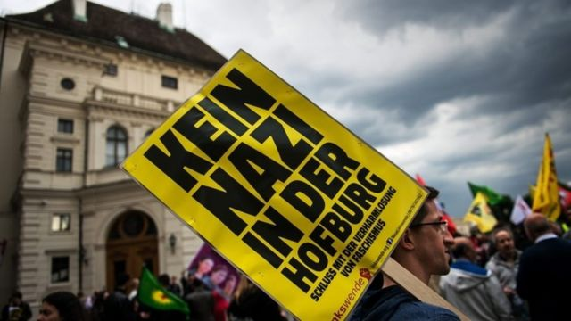 "A protestor holds a sign reading ""No Nazi in Hofburg palace"" during a demonstration against Austrian Freedom Party (FPOe) in Vienna"