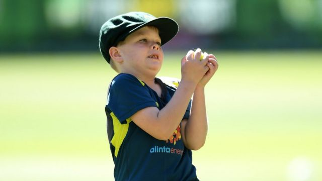 Archie Schiller catches a ball during a warm up with the Australian cricket team