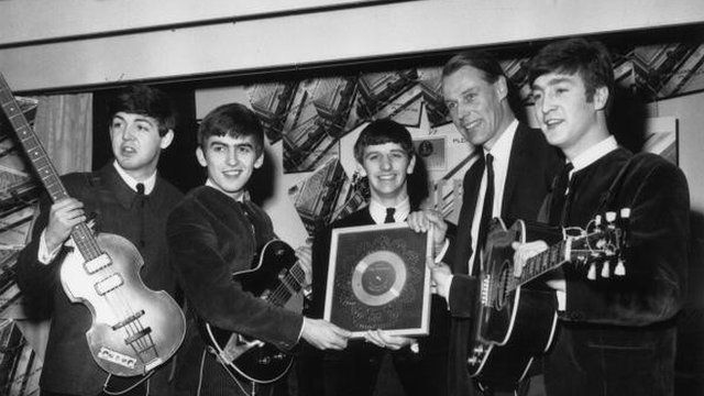 8th April 1963: British pop group The Beatles holding their silver disc. Left to right are, Paul McCartney, George Harrison, Ringo Starr, George Martin of EMI and John Lennon
