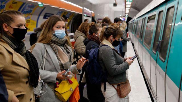 Travelers in the Paris metro.