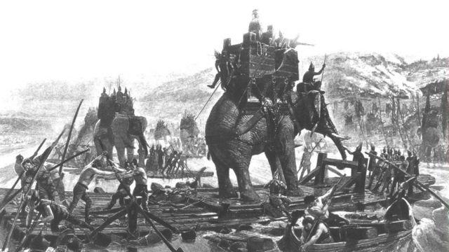 绘图描述了2000多年前,北非迦太基国将军汉尼拔在布匿战争中率军迎战罗马帝国军队的场景。