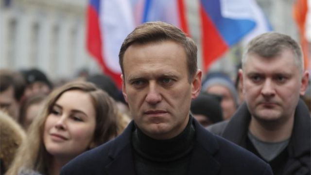 Russian opposition leader and anti-corruption activist Alexei Navalny (C) takes part in a memorial march for Boris Nemtsov marking the fifth anniversary of his assassination in Moscow, Russia, 29 February 2020