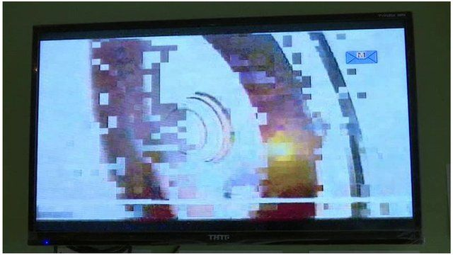 TV screen in China broadcasting BBC World News starts to pixelate (11 May 2016)