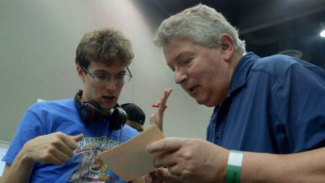 Robert e Maurizio discutindo estratégia de jogo