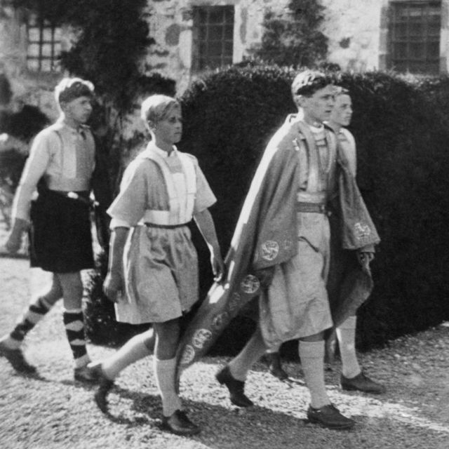 Prince Philip (center left) participating in a historic parade in Gordonstoun, 1933.