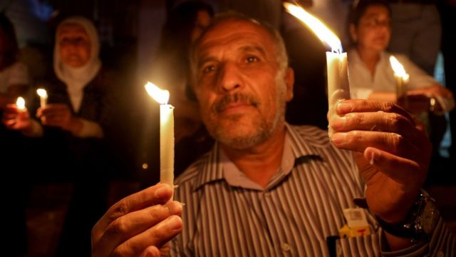 Jordanians hold candles at a vigil for six Jordanian soldiers killed in a suicide bombing