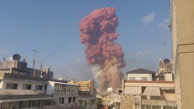 A red cloud of smoke is seen after the explosion in Beirut