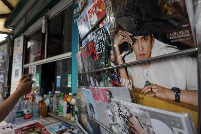 A newspaper and periodical store has a fashion magazine with Wu Yifan printed on the cover.