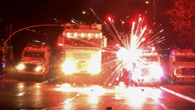 Fire in front of police trucks in Northern Ireland