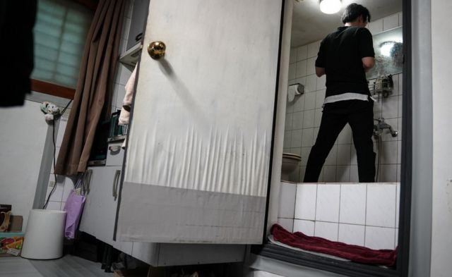 Oh kee-cheol in his bathroom with a raised floor