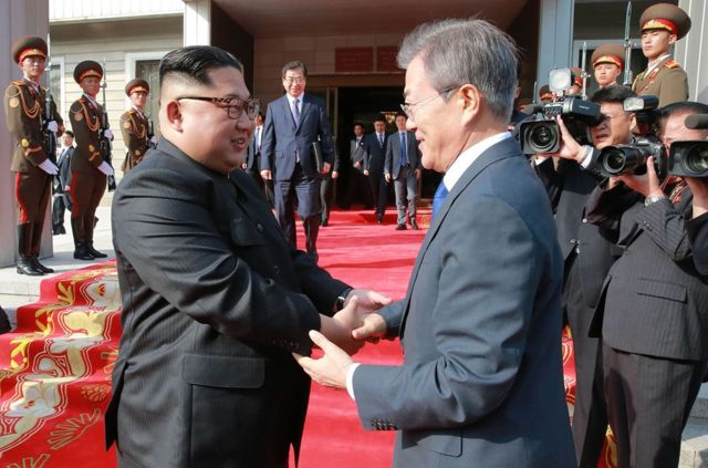 "This photograph taken on May 26, 2018 and released by North Korea""s official Korean Central News Agency (KCNA) on May 27 shows South Korea""s President Moon Jae-in (R) shaking hands with North Korea""s leader Kim Jong Un after their second summit at the north side of the truce village of Panmunjom in the Demilitarized Zone (DMZ). Kim Jong Un believes a summit with US President Donald Trump will be a landmark opportunity to end decades of confrontation, South Korea""s President Moon Jae-in said May 27 following his surprise meeting with the North Korean leader. / AFP PHOTO / KCNA VIA KNS /"