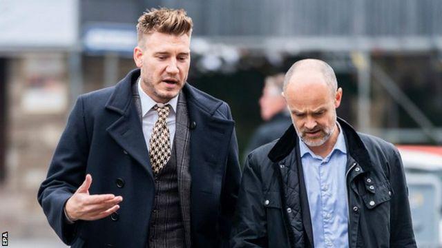 Nicklas Bendtner (left) and his lawyer Anders Nemeth arrive at court in Copenhagen
