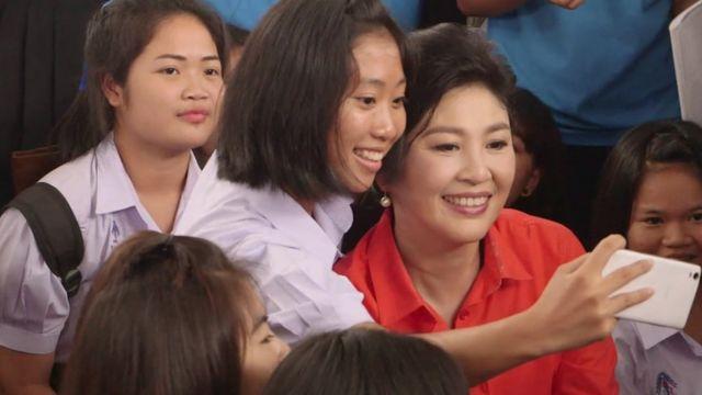 Yingluck Shinawatra and a school girl.