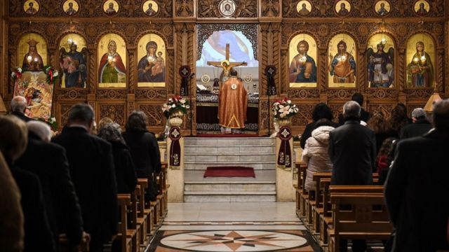 """Worshippers attend Christmas Morning mass at a Syriac Orthodox Church in Syria""""s northern city of Aleppo"""
