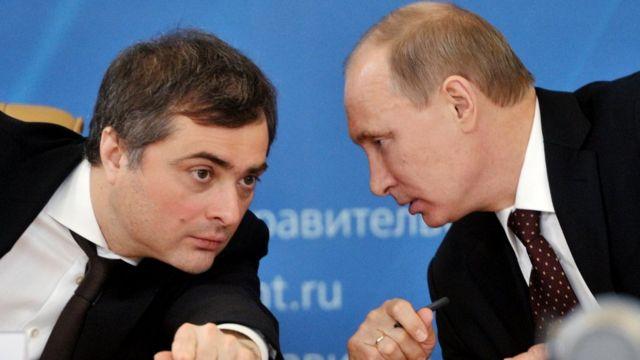 Vladislav Surkov (L) with President Vladimir Putin in 2012