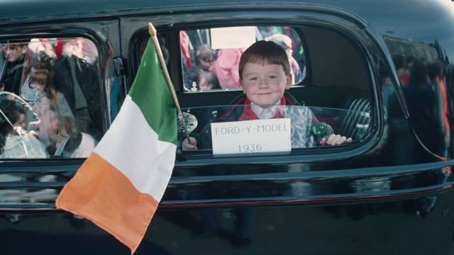 Boy with flag of Ireland.