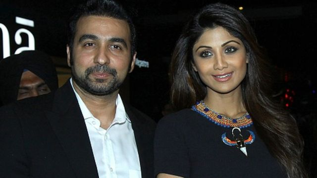 Indian Bollywood actress Shilpa Shetty (R) poses with her husband Raj Kundra as they attend the Indian premiere of the Hollywood film 'Fast & Furious 7' in Mumbai late April 1, 2015.