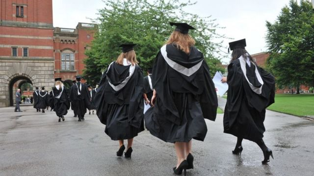 3 women graduates wearing gowns on graduation day