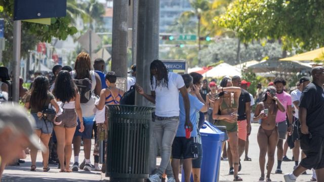 A Miami Beach street full of people