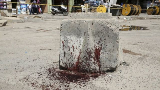 Blood-stain stone at location of blast