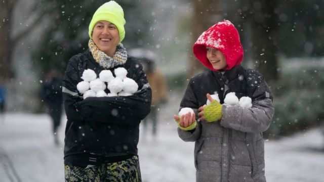 Snowball fight in Battersea Park, south-west London