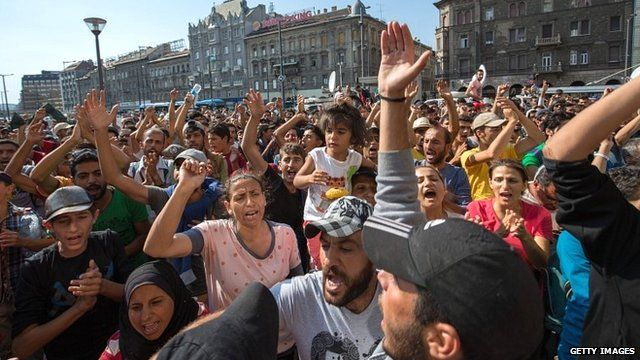 Migrants protest outside Keleti station in central Budapest after it was closed to migrants on 1 September 2015