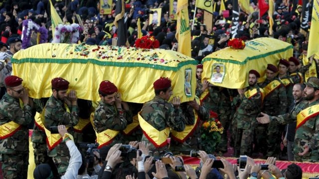 Coffins of Hezbollah fighters killed while fighting in Syria during funeral in Nabatieh, southern Lebanon October 27, 2015.
