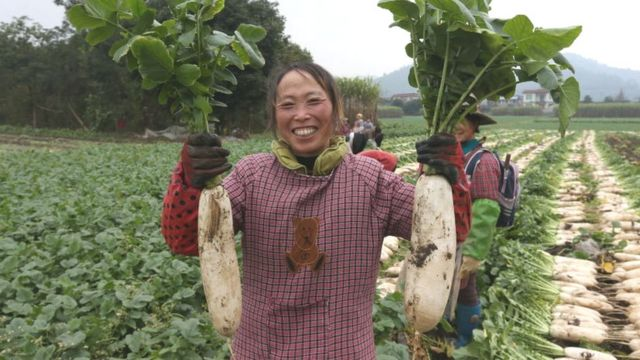 Woman holding white radishes