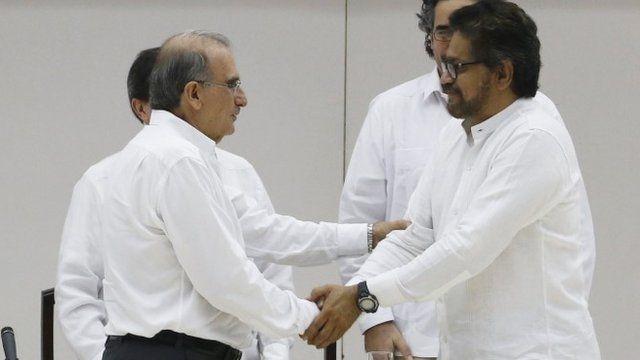 Lead government negotiator for Columbia Humberto de la Calle and the FARC lead negotiator Ivan Marquez shake hands in Havana, Cuba