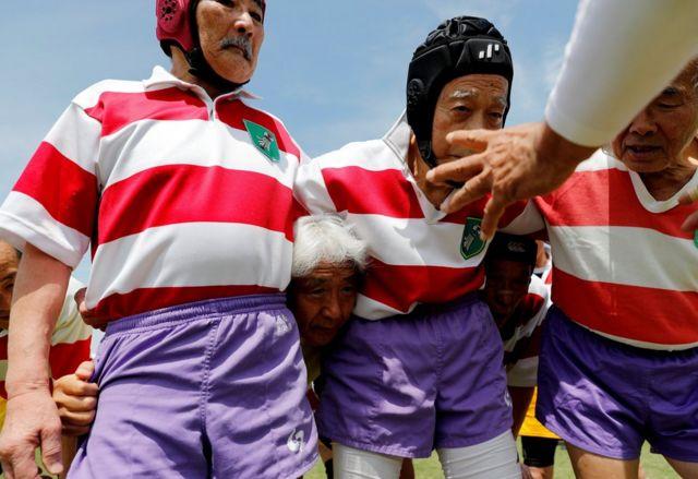 Members of Tokyo's Fuwaku Rugby Club train outdoors