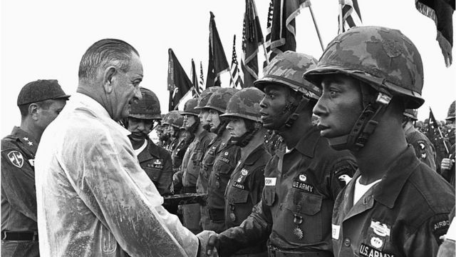 President Lyndon B Johnson shakes hands with troops
