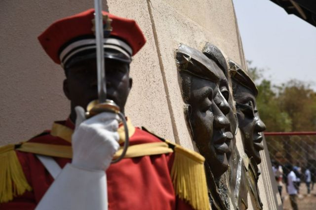 A soldier stands under the bronze statue of Burkina Faso's former President Thomas Sankara on 2 March 2019.