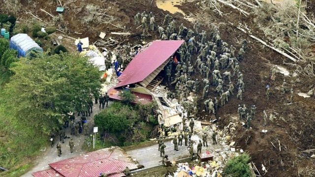 Rescue workers in the town of Atsuma