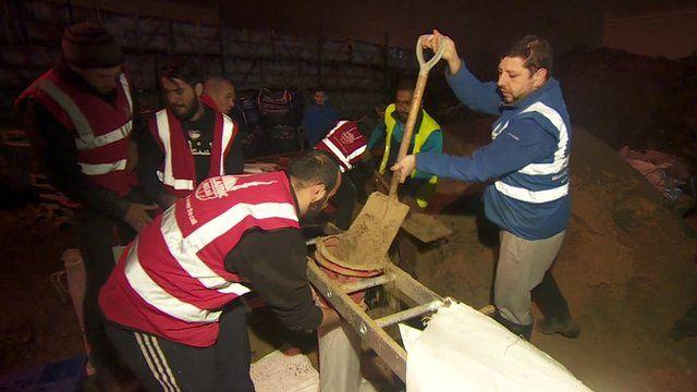Volunteers helping with sandbags