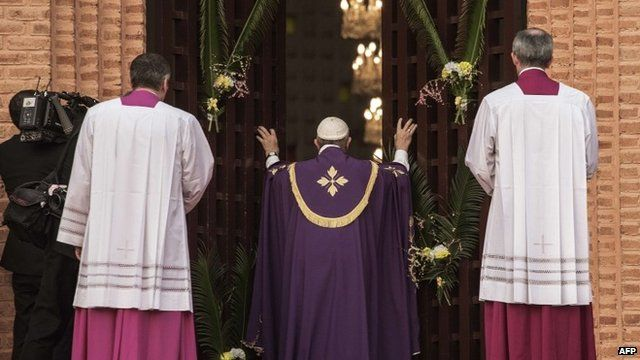 "Pope Francis makes a symbolic gesture by opening a ""Holy Door"" at Bangui Cathedral in the Central African Republic"