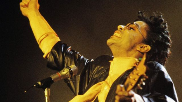 This photo taken on June 17, 1987 shows musician Prince performing onstage during his concert at the Bercy venue in Paris.