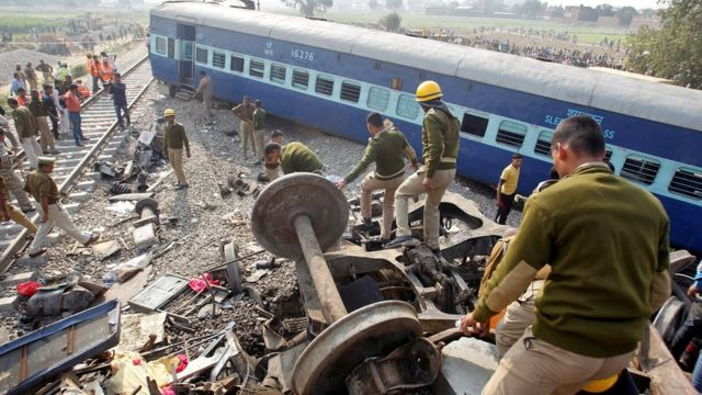 Rescue workers search for survivors at the site of a train derailment in Pukhrayan, south of Kanpur city, India November 20, 2016.
