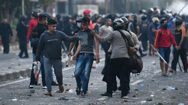 Police detain protesters after clashes in Jakarta, Indonesia, early May 22, 2019