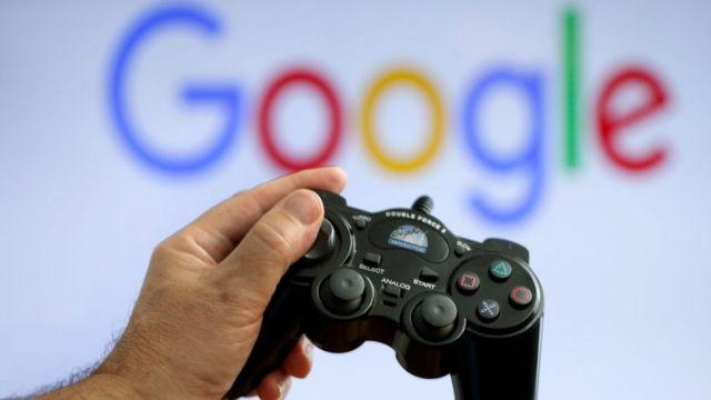 mando de consola y logo de Google