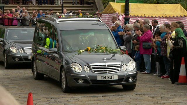 Hearse carrying Jo Cox drives past applauding crowds.