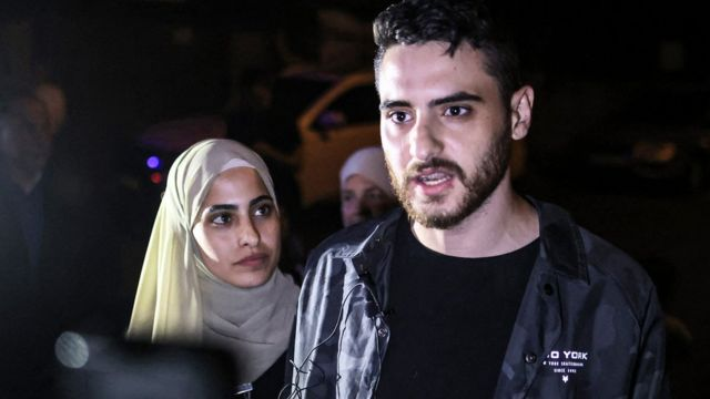 Palestinian activist twins (L to R) Muna and Mohammad el-Kurd, speak to reporters after being released by Israeli authorities in the neighbourhood of Sheikh Jarrah in Israeli-annexed east Jerusalem, 6 June 2021