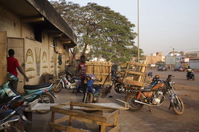 Men prepare motorbikes to be sent out to make deliveries at Buru Niouman Bakery in Bamako, Mali on 5 February 2019.