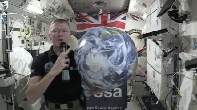 Tim shows what happens when you touch your toes in zero gravity.